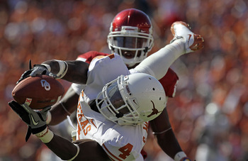 DALLAS - OCTOBER 02:  Cornerback Aaron Williams #4 of the Texas Longhorns drops a pass intended for Ryan Broyles #85 of the Oklahoma Sooners in the second quarter at the Cotton Bowl on October 2, 2010 in Dallas, Texas.  (Photo by Ronald Martinez/Getty Ima