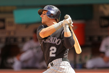 MIAMI GARDENS, FL - APRIL 24:  Troy Tulowitzki #2 of the Colorado Rockies hits a 2 RBI double during a game against the Florida Marlins  at Sun Life Stadium on April 24, 2011 in Miami Gardens, Florida.  (Photo by Mike Ehrmann/Getty Images)