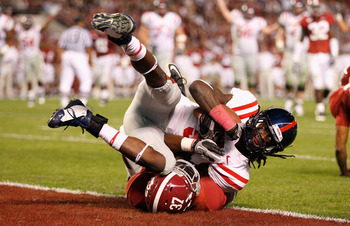 TUSCALOOSA, AL - OCTOBER 16:  Melvin Harris #5 of the Ole Miss Rebels scores a touchdown over Robert Lester #37 of the Alabama Crimson Tide at Bryant-Denny Stadium on October 16, 2010 in Tuscaloosa, Alabama.  (Photo by Kevin C. Cox/Getty Images)