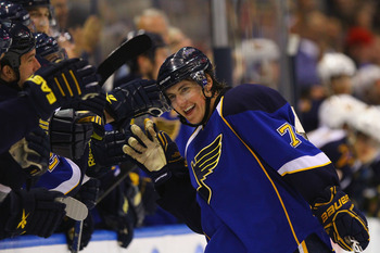 ST. LOUIS - OCTOBER 30: T.J. Oshie #74 of the St. Louis Blues is congratulated by his teammates after scoring a goal during the overtime shootout against the Atlanta Thrashers at the Scottrade Center on October 30, 2010 in St. Louis, Missouri.  The Blues