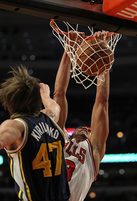 CHICAGO, IL - MARCH 12: Joakim Noah #13 of the Chicago Bulls dunks the ball against Andrei Kirilenko #47 of the Utah Jazz at the United Center on March 12, 2011 in Chicago, Illinois. The Bulls defeated the Jazz 118-100. NOTE TO USER: User expressly acknow