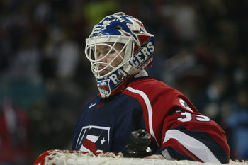 SALT LAKE CITY - FEBRUARY 22:  Goaltender Mike Richter #35 of the USA takes a rest during a break in the game against Russia in the men's ice hockey semifinal during the Salt Lake City Winter Olympic Games at the E Center in Salt Lake City, Utah. USA defe