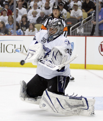 PITTSBURGH, PA - APRIL 27:  Dwayne Roloson #35 of the Tampa Bay Lightning makes a save against the Pittsburgh Penguins in Game Seven of the Eastern Conference Quarterfinals during the 2011 NHL Stanley Cup Playoffs at Consol Energy Center on April 27, 2011