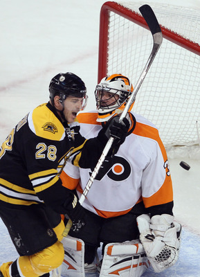 BOSTON, MA - JANUARY 13:  Mark Recchi #28 of the Boston Bruins celebrates teammate Zdeno Chara's goal in the first period as Brian Boucher #33 of the Philadelphia Flyers stands by on January 11, 2011 at the TD Garden in Boston, Massachusetts.  (Photo by E