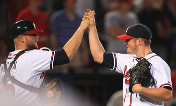 ATLANTA, GA - APRIL 08:  Teammates Brian McCann #16 and Craig Kimbrel #46 of the Atlanta Braves celebrate after a 6-3 victory on their opening day game against the Philadelphia Phillies at Turner Field on April 8, 2011 in Atlanta, Georgia.  (Photo by Stre