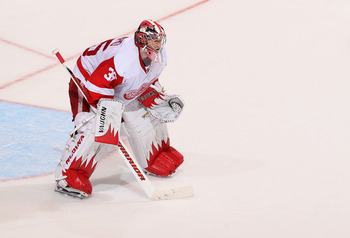 GLENDALE, AZ - APRIL 20:  Goaltender Jimmy Howard #35 of the Detroit Red Wings in action in Game Four of the Western Conference Quarterfinals against the Phoenix Coyotes during the 2011 NHL Stanley Cup Playoffs at Jobing.com Arena on April 20, 2011 in Gle