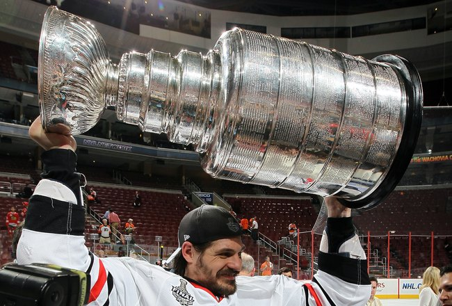 PHILADELPHIA - JUNE 09:  Brent Sopel #5 of the Chicago Blackhawks hoists the Stanley Cup after teammate Patrick Kane scored the game-winning goal in overtime to defeat the Philadelphia Flyers 4-3 and win the Stanley Cup in Game Six of the 2010 NHL Stanley