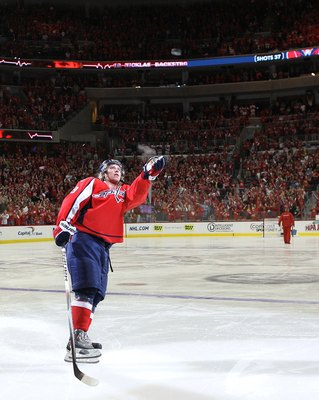 WASHINGTON - APRIL 17:  Nicklas Backstrom #19 of the Washington Capitals is saluted by the fans following his hattrick against the Montreal Canadiens in Game Two of the Eastern Conference Quarterfinals during the 2010 NHL Stanley Cup Playoffs at the Veriz