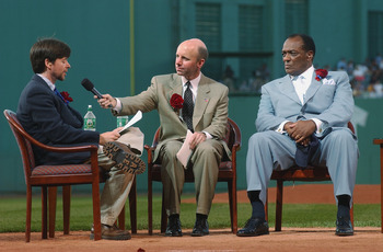 BOSTON - JULY 22:  Former Red Sox pitcher Earl Wilson (R) and broadcaster Sean McDonough (C) listen to baseball historian and filmmaker Ken Burns (L) share historical perspective on Ted Williams during the Ted Williams tribute on July 22, 2002 at Fenway P