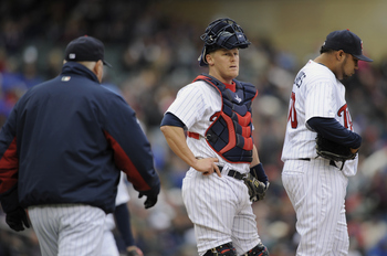 MINNEAPOLIS, MN - APRIL 28: Manager Ron Gardenhire #35 walks out to the mound to reliever pitcher Jose Mijares #50 of the Minnesota Twins while catcher Steve Holm #27 looks on during in the seventh inning of their game against the Tampa Bay Rays on April