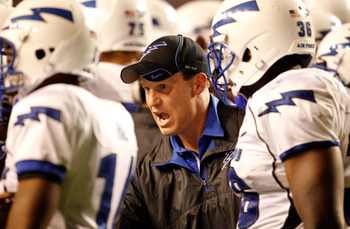 FORT WORTH, TX - OCTOBER 23:  Head coach Troy Calhoun of the Air Force Falcons leads his team on the field against the TCU Horned Frogs at Amon G. Carter Stadium on October 23, 2010 in Fort Worth, Texas.  (Photo by Tom Pennington/Getty Images)