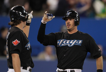 TORONTO, ON - APRIL 20:  J.P. Arencibia #9 of the Toronto Blue Jays (R) celebrates his home run in the second inning with Travis Snider #45 during their game with the New York Yankees at Rogers Centre on April 20, 2011 in Toronto, Canada.  (Photo by Scott
