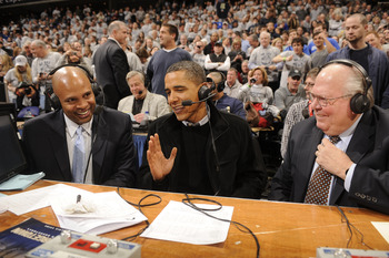 WASHINGTON - JANUARY 30:  President of the United States Barack Obama (C) talks to CBS annoucers Clark Kellogg and Verne Lundquist during a college basketball game between Georgetown Hoyas and the Duke Blue Devils on January 30, 2010 at the Verizon Center