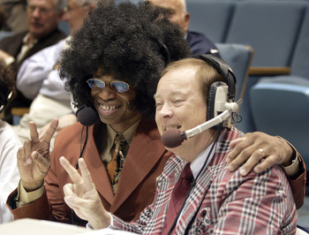CHAPEL HILL, NC - FEBRUARY 16:  ESPN television announcers Len Elmore (L) and Mike Patrick pose for pictures dressed in 1980s clothing before the start of a retro night game between the Virginia Cavaliers and the North Carolina Tar Heels in an Atlantic Co