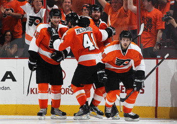 PHILADELPHIA, PA - APRIL 26:  Ville Leino #22 celebrates his third period goal against the Buffalo Sabres with teammates Danny Briere #48 and Andrej Meszaros #41 of Philadelphia Flyers and in Game Seven of the Eastern Conference Quarterfinals during the 2