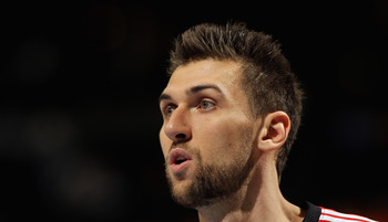 DENVER, CO - MARCH 21:  Andrea Bargnani #7 of the Toronto Raptors looks on during a break in the action against the Denver Nuggets at the Pepsi Center on March 21, 2011 in Denver, Colorado. The Nuggets defeated the Raptors 123-90. NOTE TO USER: User expre