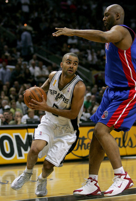 SAN ANTONIO - JUNE 23:  Tony Parker #9 of the San Antonio Spurs moves around Elden Campbell #41 of the Detroit Pistons in the first half of Game seven of the 2005 NBA Finals at SBC Center on June 23, 2005 in San Antonio, Texas.  NOTE TO USER: User express