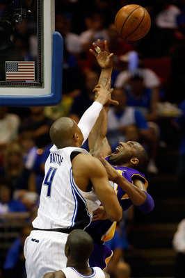 ORLANDO, FL - JUNE 09:  Kobe Bryant #24 of the Los Angeles Lakers has his shot blocked by Tony Battie #4 of the Orlando Magic in the second quarter of Game Three of the 2009 NBA Finals on June 9, 2009 at Amway Arena in Orlando, Florida.  NOTE TO USER:  Us
