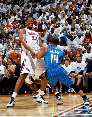 ATLANTA, GA - APRIL 22:  Jason Collins #34 of the Atlanta Hawks draws a foul from Jameer Nelson #14 of the Orlando Magic during Game Three of the Eastern Conference Quarterfinals in the 2011 NBA Playoffs at Philips Arena on April 22, 2011 in Atlanta, Geor