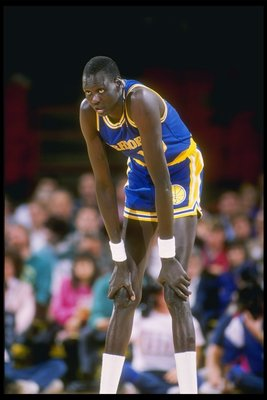 1989-1990:  Manute Bol of the Golden State Warriors looks on during a basketball game. Mandatory Credit: Tim de Frisco  /Allsport