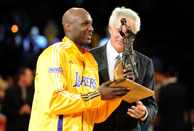 LOS ANGELES, CA - APRIL 20:  Lamar Odom #7 of the Los Angeles Lakers receives the Kia Six Man of the Year Award from Lakers General Manager Mitch Kupchak before Game Two of the Western Conference Quarterfinals in the 2011 NBA Playoffs against the New Orle