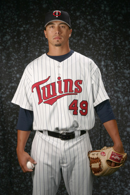 FORT MYERS, FL - FEBRUARY 27: Kyle Lohse #49 of the Twins poses for a portrait during the Minnesota Twins Photo Day at the Lee County Sports complex on February 27, 2006 in Fort Myers, Florida. (Photo by Nick Laham/Getty Images)