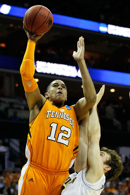 CHARLOTTE, NC - MARCH 18:  Tobias Harris #12 of the Tennessee Volunteers shoots over Zack Novak #0 of the Michigan Wolverines in the first half during the second round of the 2011 NCAA men's basketball tournament at Time Warner Cable Arena on March 18, 20