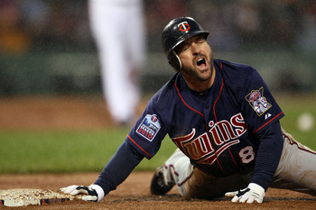 BOSTON - MAY 19:  Nick Punto #8 of the Minnesota Twins reacts after he is picked off at first base in the third inninga against the Boston Red Sox on May 19, 2010 at Fenway Park in Boston, Massachusetts.  (Photo by Elsa/Getty Images)