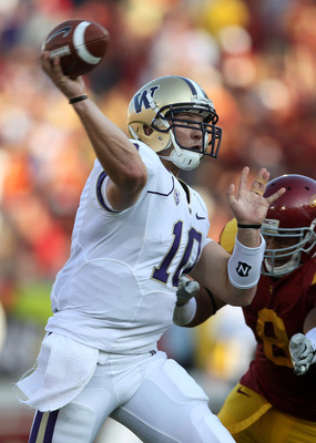 LOS ANGELES - OCTOBER 2:  Quarterback Jake Locker #10 of the Washington Huskies throws a pass against the USC Trojans at the Los Angeles Memorial Coliseum on October 2, 2010 in Los Angeles, California.    (Photo by Stephen Dunn/Getty Images)