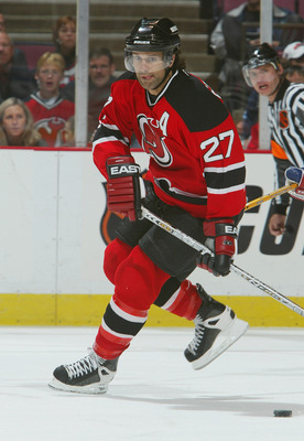 EAST RUTHERFORD, NJ - OCTOBER 3:  Defenseman Scott Niedermayer #27 of the New Jersey Devils skates with the puck against the New York Rangers during the preseason NHL game on October 3, 2003 at Continental Airlines Arena in East Rutherford, New Jersey. Th