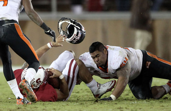 PALO ALTO, CA - NOVEMBER 27:  Stephen Paea #54 of the Oregon State Beavers loses his helmet as he tackles Tyler Gaffney #25 of the Stanford Cardinal at Stanford Stadium on November 27, 2010 in Palo Alto, California.  (Photo by Ezra Shaw/Getty Images)