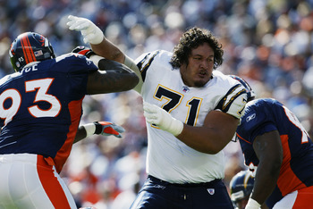 DENVER - OCTOBER 6:  Guard Toniu Fonoti #71 of the San Diego Chargers and defensive end Trevor Pryce #93 of the Denver Broncos struggle for ground in the second quarter of their NFL game on October 6, 2002, at Mile High in Denver, Colorado.  The Broncos w