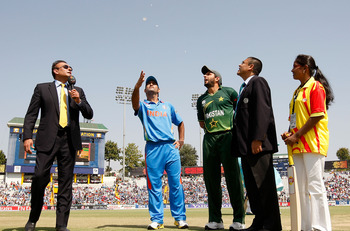 MOHALI, INDIA - MARCH 30: (L-R) Commentator Ravi Shastri, M.S. Dhoni of India, Shahid Afridi of Pakistan ,match referee Ranjan Madugalle and Lays mascot Arancha at the toss during the 2011 ICC World Cup second Semi-Final between Pakistan and India at Punj