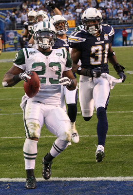 SAN DIEGO - JANUARY 17:  Running back Shonn Greene #23 of the New York Jets scores a touchdown in the fourth quarter in front of cornerback Antonio Cromartie #31 of the San Diego Chargers in the AFC Divisional Playoff Game at Qualcomm Stadium on January 1