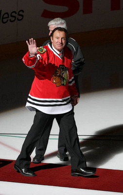 CHICAGO - MARCH 19: Former goaltender Tony Esposito of the Chicago Blackhawks waves to the crowd before being honored at a game between the Blackhawks and the Washington Capitals on March 19, 2008 at the United Center in Chicago, Illinois. (Photo by Jonat