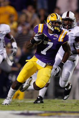 BATON ROUGE, LA - NOVEMBER 13:  Patrick Peterson #7 of the Louisiana State University Tigers runs back an interception against the Louisiana Monroe Warhawks at Tiger Stadium on November 13, 2010 in Baton Rouge, Louisiana.  (Photo by Chris Graythen/Getty I