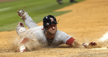 HOUSTON - APRIL 27:  Nick Punto #8 of the St. Louis Cardinals slides into home in the seventh inning on a single by Albert Pujols against the Houston Astros at Minute Maid Park on April 27, 2011 in Houston, Texas.  (Photo by Bob Levey/Getty Images)