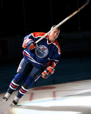 EDMONTON, CANADA - OCTOBER 18:  Edmonton Oiler great Paul Coffey takes a final skate around the ice after his number 7 banner was raised to the rafters during a special ceremony on October 18, 2005 at Rexall Place in Edmonton, Alberta, Canada.  (Photo by