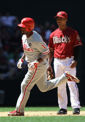 PHOENIX, AZ - APRIL 27:  Jimmy Rollins #11 of the Philadelphia Phillies rounds the bases past infielder Melvin Mora #4 of the Arizona Diamondbacks after Rollins hit a two run home run during the fifth inning of the Major League Baseball game at Chase Fiel
