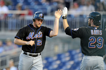 WASHINGTON, DC - APRIL 26:  Daniel Murphy #28 of the New York Mets celebrates with Ike Davis #29 after scoring in the third inning against the Washington Nationals at Nationals Park on April 26, 2011 in Washington, DC.  (Photo by Greg Fiume/Getty Images)