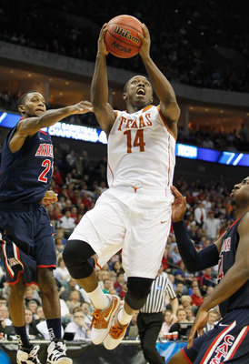 TULSA, OK - MARCH 20:  J'Covan Brown #14 of the Texas Longhorns goes up for a shot against the Arizona Wildcats during the third round of the 2011 NCAA men's basketball tournament at BOK Center on March 20, 2011 in Tulsa, Oklahoma.  (Photo by Tom Penningt