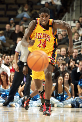DENVER - DECEMBER 6:  Marvin Williams #24 of the Atlanta Hawks chases the ball after the Denver Nuggets lost control of it in the second quarter on December 6, 2005 at the Pepsi Center in Denver, Colorado.  NOTE TO USER:  User expressly acknowledges and a