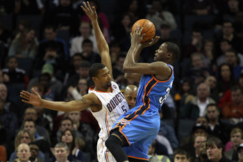 CHARLOTTE, NC - DECEMBER 21:  Kevin Durant #35 of the Oklahoma Thunder shoots the ball over Dominic McGuire #5 of the Charlotte Bobcats during their game at Time Warner Cable Arena on December 21, 2010 in Charlotte, North Carolina. NOTE TO USER: User expr