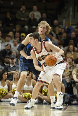 DENVER - DECEMBER 18:  Nikoloz Tskitishvili #22 of the Denver Nuggets is defended by Dirk Nowitzki #41 of the Dallas Mavericks during the game at Pepsi Center on December 18, 2002 in Denver, Colorado.  The Mavs won 80-75.   NOTE TO USER: User expressly ac