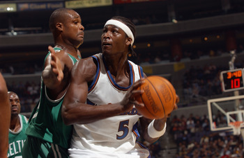 WASHINGTON - OCTOBER 31:  Kwame Brown #5 of the Washington Wizards is defended by Antoine Walker #8 of the Boston Celtics during the game at MCI Center on October 31, 2002 in Washington, D.C.  The Wizards won 114-69.  NOTE TO USER: User expressly acknowle