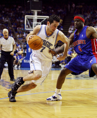 ORLANDO, FL - APRIL 28:  J.J. Redick #7 of the Orlando Magic tries to drive past Flip Murray #6 of the Detroit Pistons in the first half in Game Four of the Eastern Conference Quarterfinals during the 2007 NBA Playoffs at Amway Arena on April 28, 2007 in