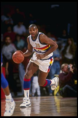 Forward Jerome Lane of the Denver Nuggets moves the ball during a game at the McNichols Sports Arena in Denver, Colorado.