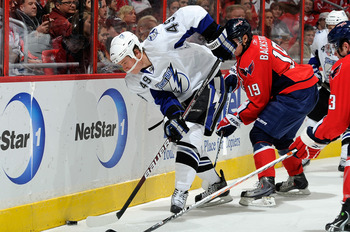 WASHINGTON - NOVEMBER 26:  Blair Jones #49 of the Tampa Bay Lightning battles for the puck with Nicklas Backstrom #19 of the Washington Capitals at the Verizon Center on November 26, 2010 in Washington, DC.  (Photo by Greg Fiume/Getty Images)