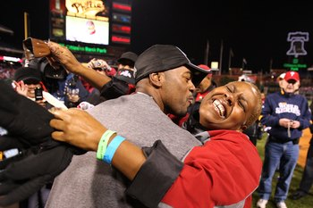 PHILADELPHIA - OCTOBER 29:  Jimmy Rollins #11 (L) of the Philadelphia Phillies celebrates winning the World Series with his mother Gigi on the field after their 4-3 win against the Tampa Bay Rays during the continuation of game five of the 2008 MLB World