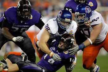 GLENDALE, AZ - JANUARY 04:  Ryan Winterswyk #98 of the Boise State Broncos tackles quarterback Andy Dalton #14 of the TCU Horned Frogs on a quarterback keeper in the third quarter during the Tostitos Fiesta Bowl at the Universtity of Phoenix Stadium on Ja